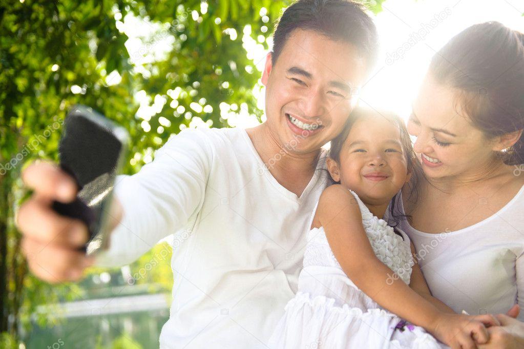 Asian Family Taking Photographs
