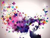 portrét ženy s motýli letící z vlasů.