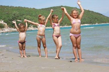 KIds on the sunny beach