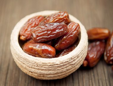 Delicious dates in small bowl