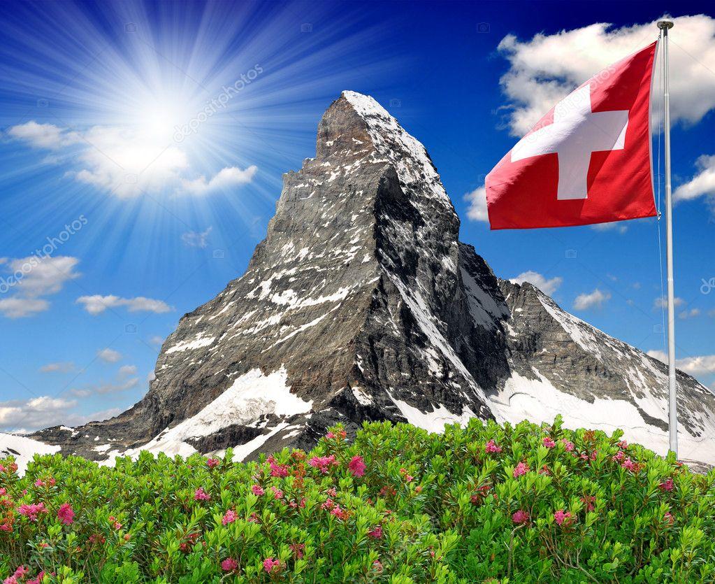 Matterhorn with Swiss flag - Swiss Alps