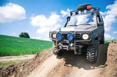 Offroad through muddy field