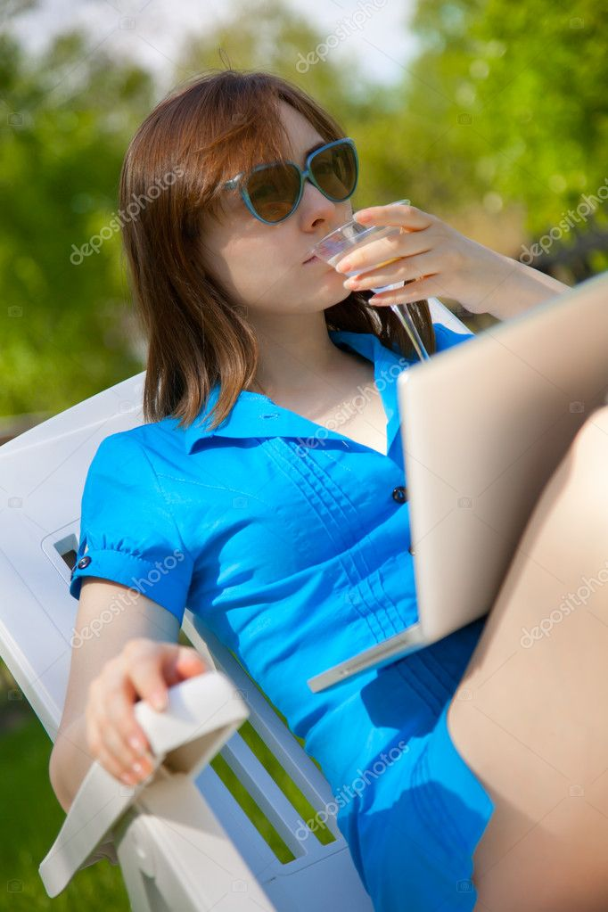 Businesswoman with a glass of martini outdoors