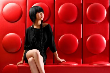 Asian fashion model on red lego background