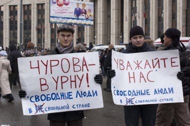 MOSCOW - DECEMBER 24: Two men with posters calling for resignati