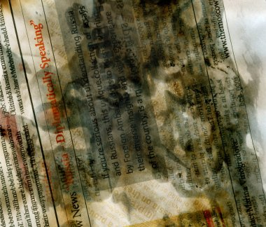 Washed out burnt newspaper