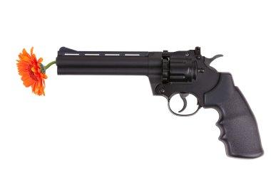 Orange flower hanging from the gun barrel