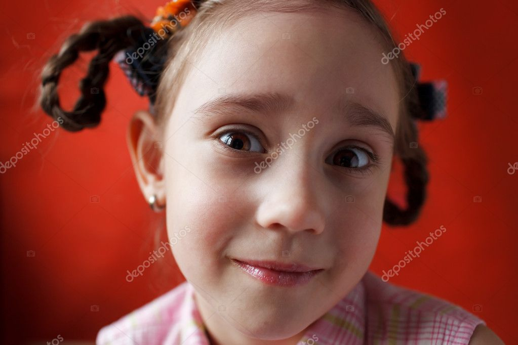 Little surprised girl with pigtails