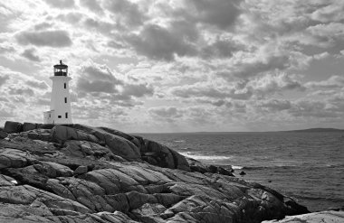 Lighthouse in dramatic sky, black and white