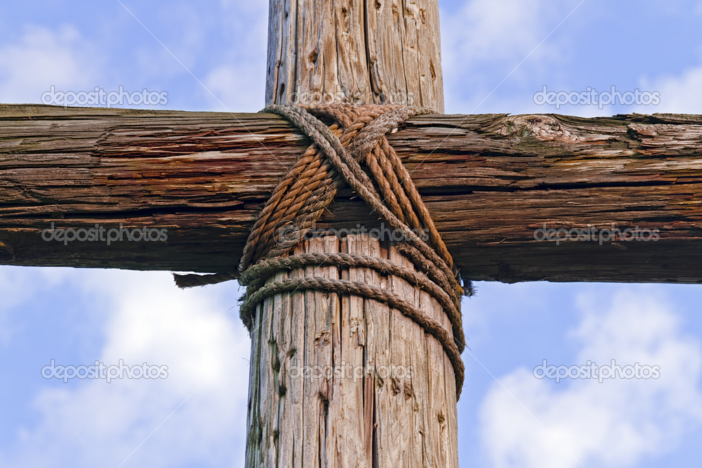 A Rugged Wooden Crosses Stands Against Blue Cloudy Sky Photographed Closeup Photo By KennethKeifer
