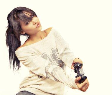 Cute Female Video Gamer Girl controlling remote