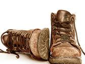 Fotografie pracovní a bezpečnostní obuv izolované proti Bílému pozadí