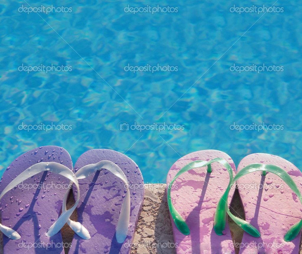Flip flops near the swimming pool with blue water stock - Where is my nearest swimming pool ...