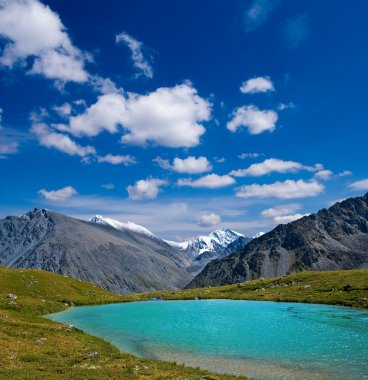 Emerald lake in altai mountains
