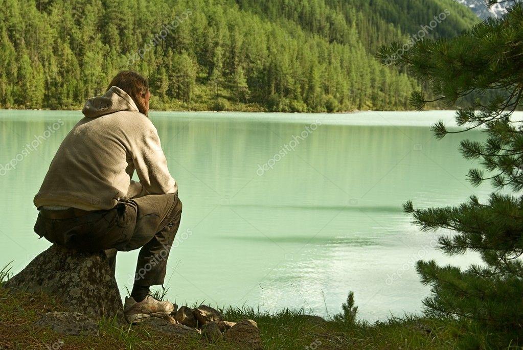 Man sitting near the lake