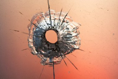 Bullet hole in glass