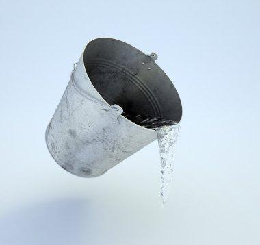 Metal bucket full of water levitating over the floor