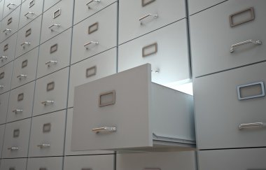 File cabinet with an open drawer and light
