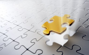 Jigsaw puzzle with a single golden piece