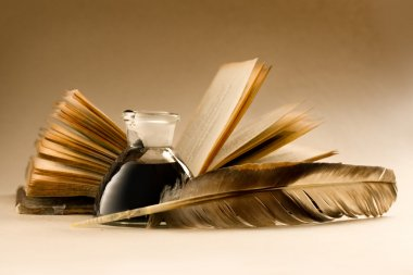 An old book with a feather