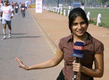 Young female journalist covering the marathon, delhi, india