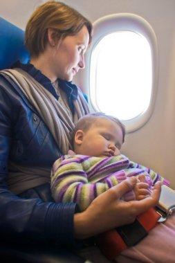 Mother and baby on aeroplane