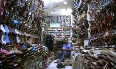 Salesman inside a footwear shop, delhi, india
