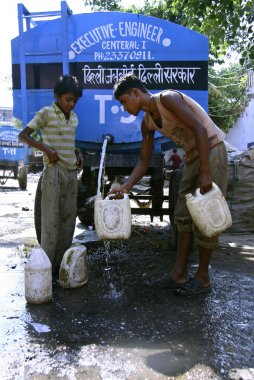 Boys filling water in cans, delhi, india