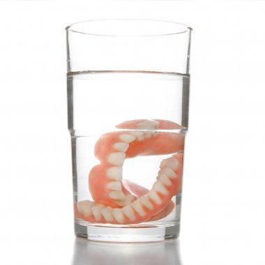 Denture in glass