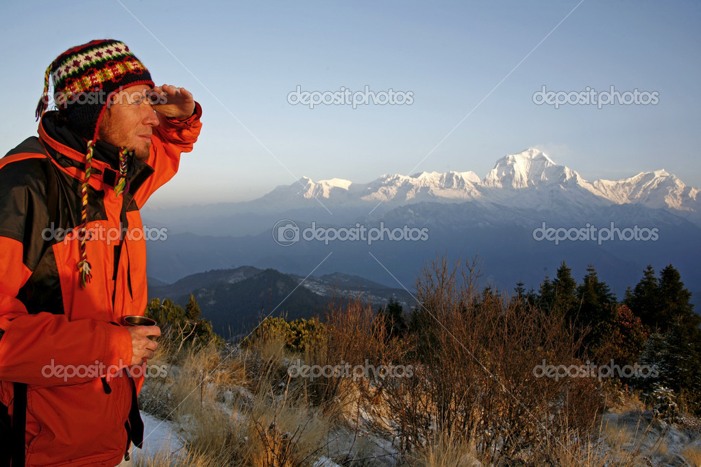 Mountaineerer looking at a mountain range