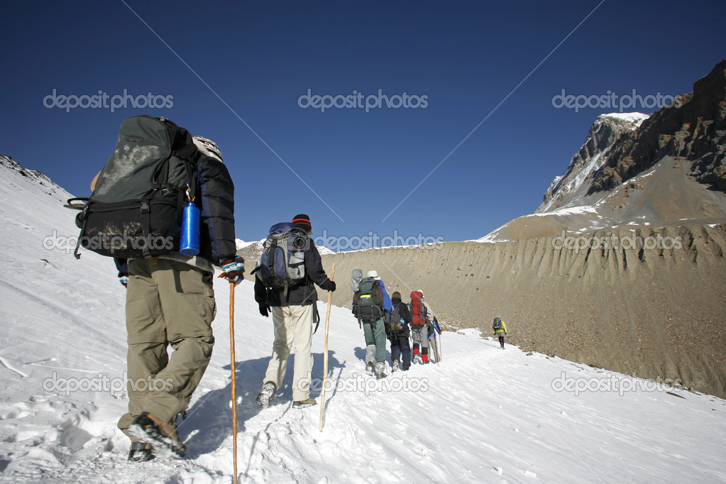 Mountaineers trekking to top of thorong-la, annapurna, nepal