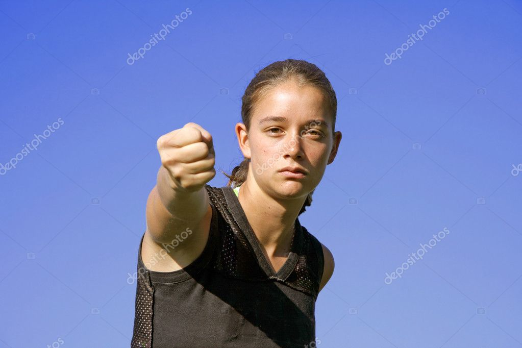 Attractive young woman practising self defense