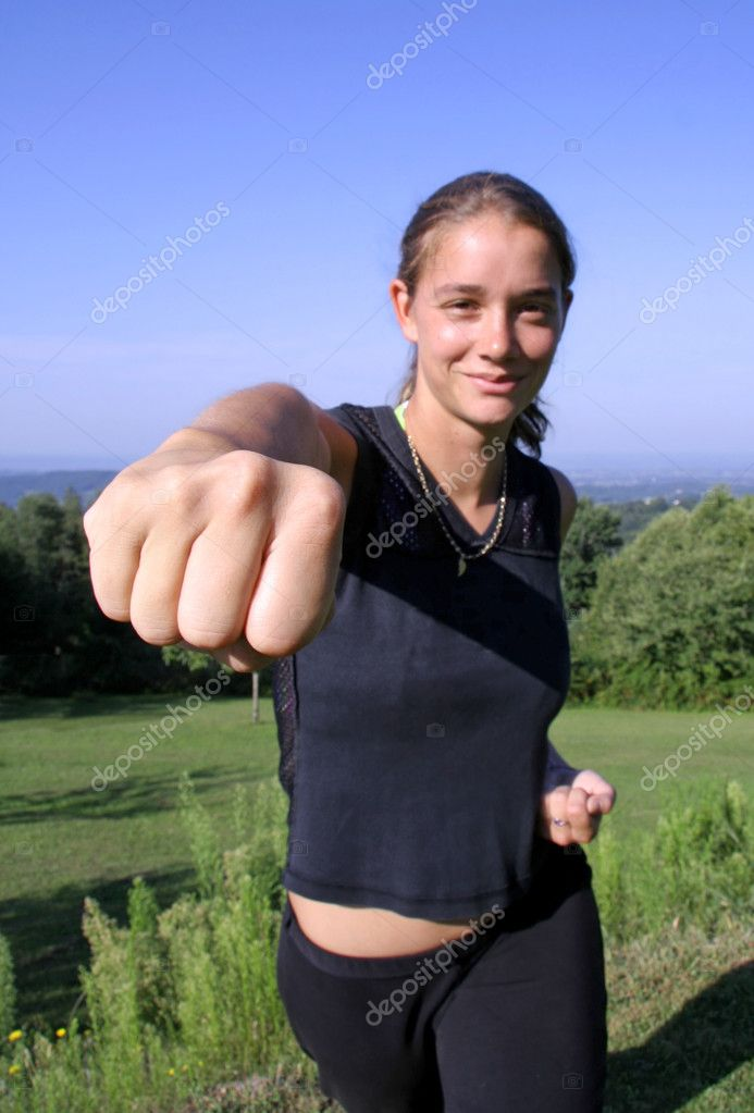 Friendly punch - attractive young woman practicing self defense