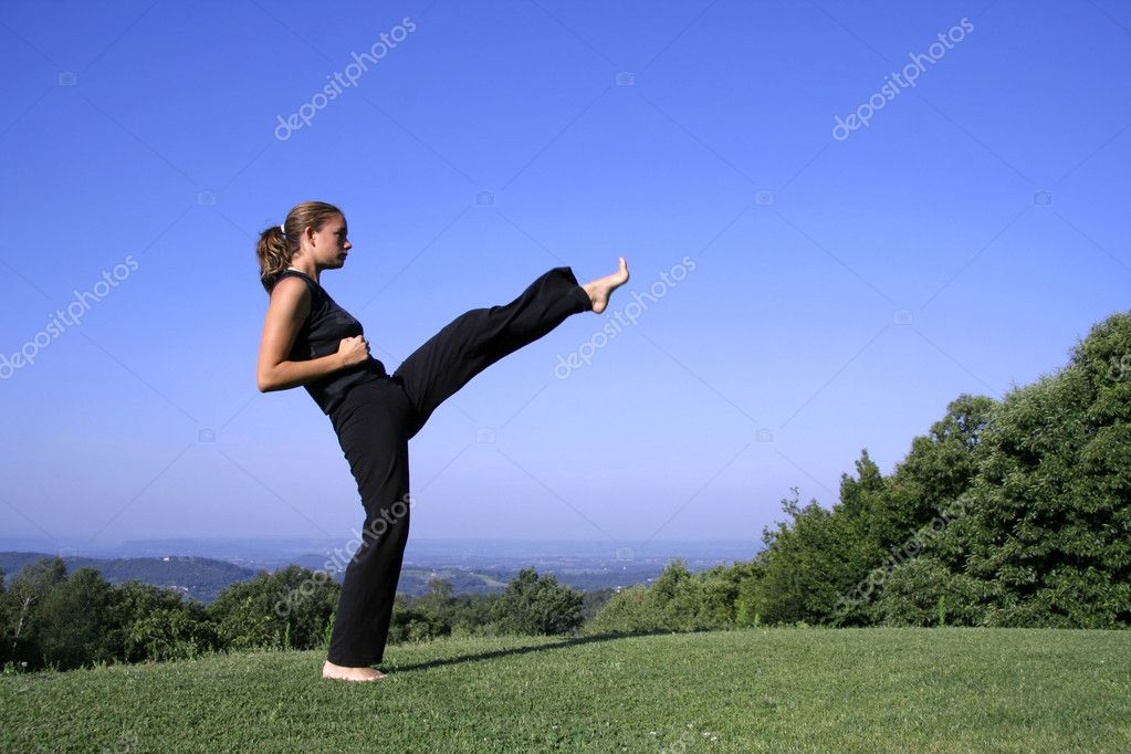 Attractive young woman practicing self defense
