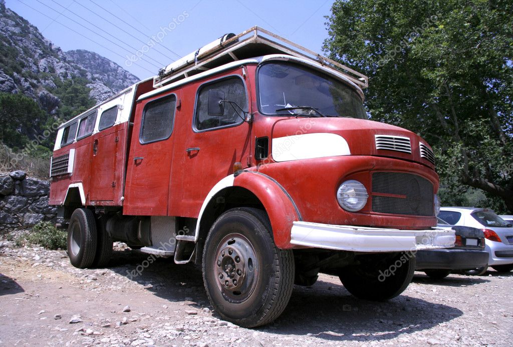 Red fire truck converted into a campervan
