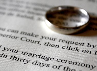 A Marriage Certificate and Gold Wedding Ring