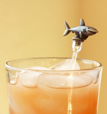 A Shark Swizzle Stick in a Mixed Drink