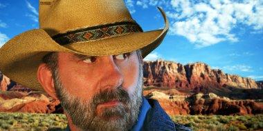 A Cowboy with the Vermilion Cliffs Behind