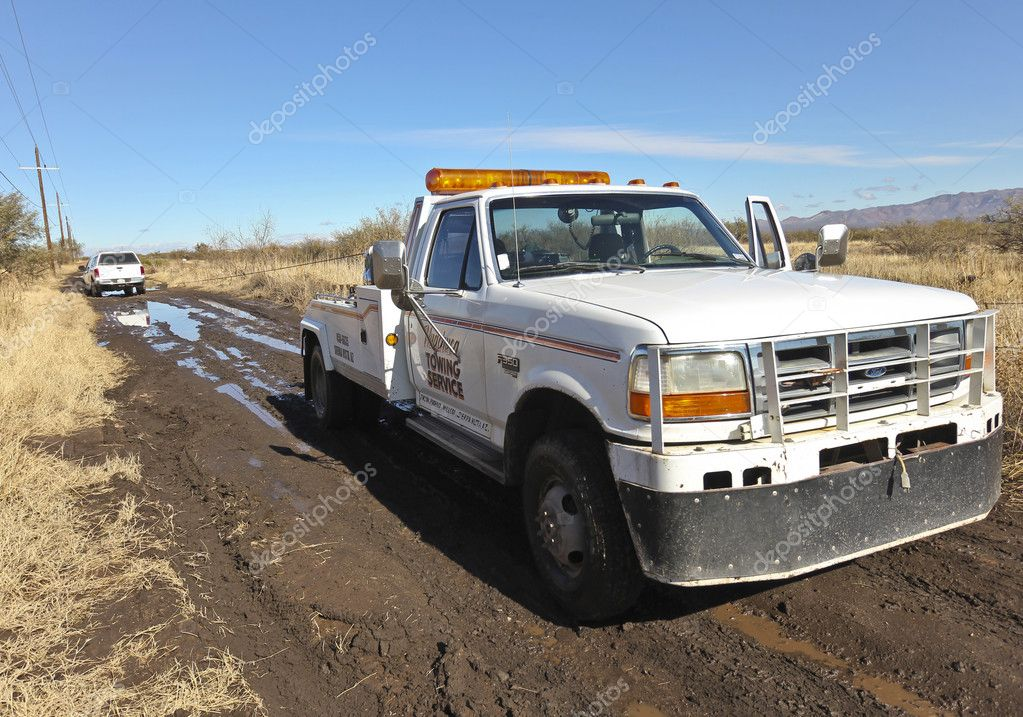 A Tow Truck Rescues a Stuck Car