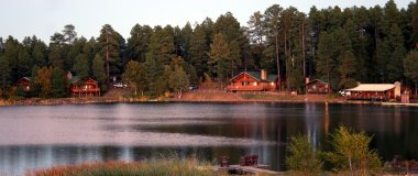 As Twilight Blankets the Cabins on a Mountain Lake