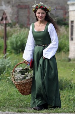 Medieval woman with busket