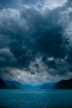 Fjord with dark clouds