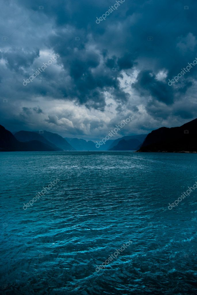Fjord with dark clouds II