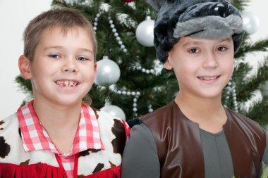 Two boys at the christmas masket ball