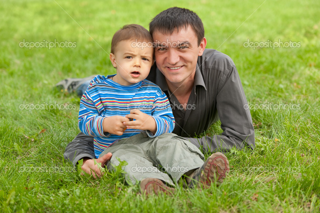 Surprised toddler with his father