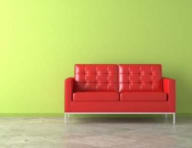 Red couch on green wall