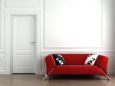Red couch on white interior wall