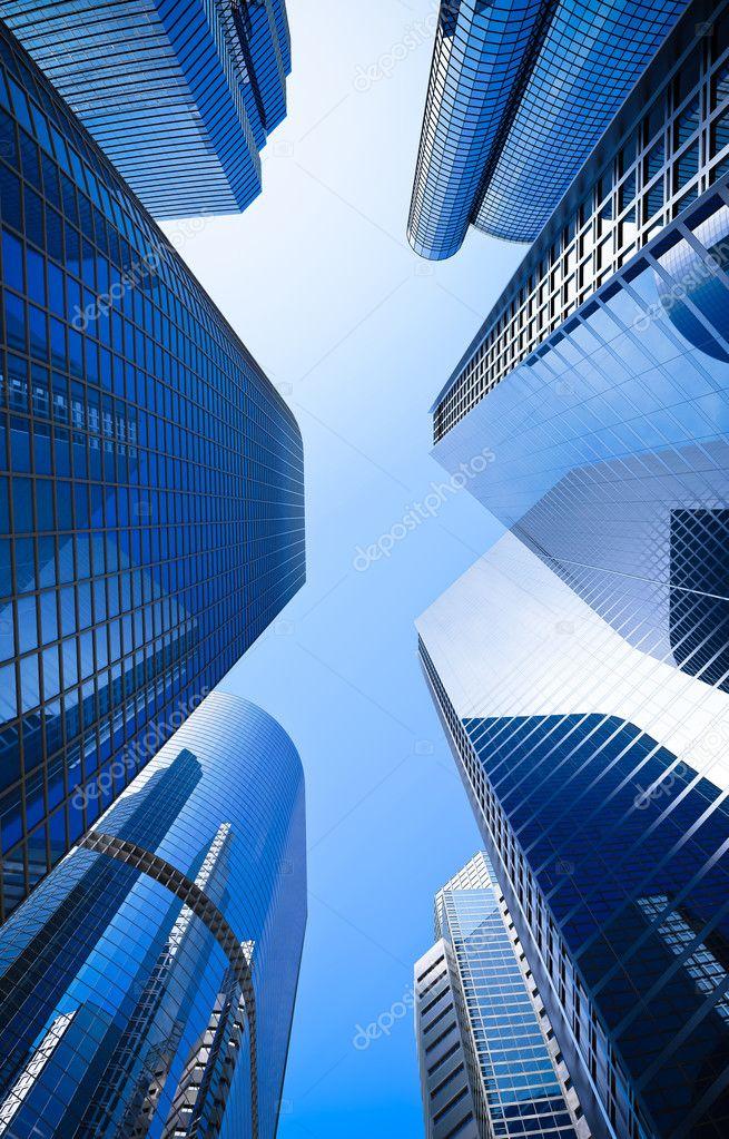 Blue highrise glass skyscraper street low angle shot