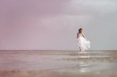Woman walking on the sea shore