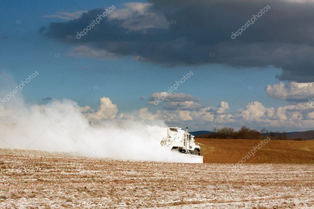 Truck Spreading Limestone